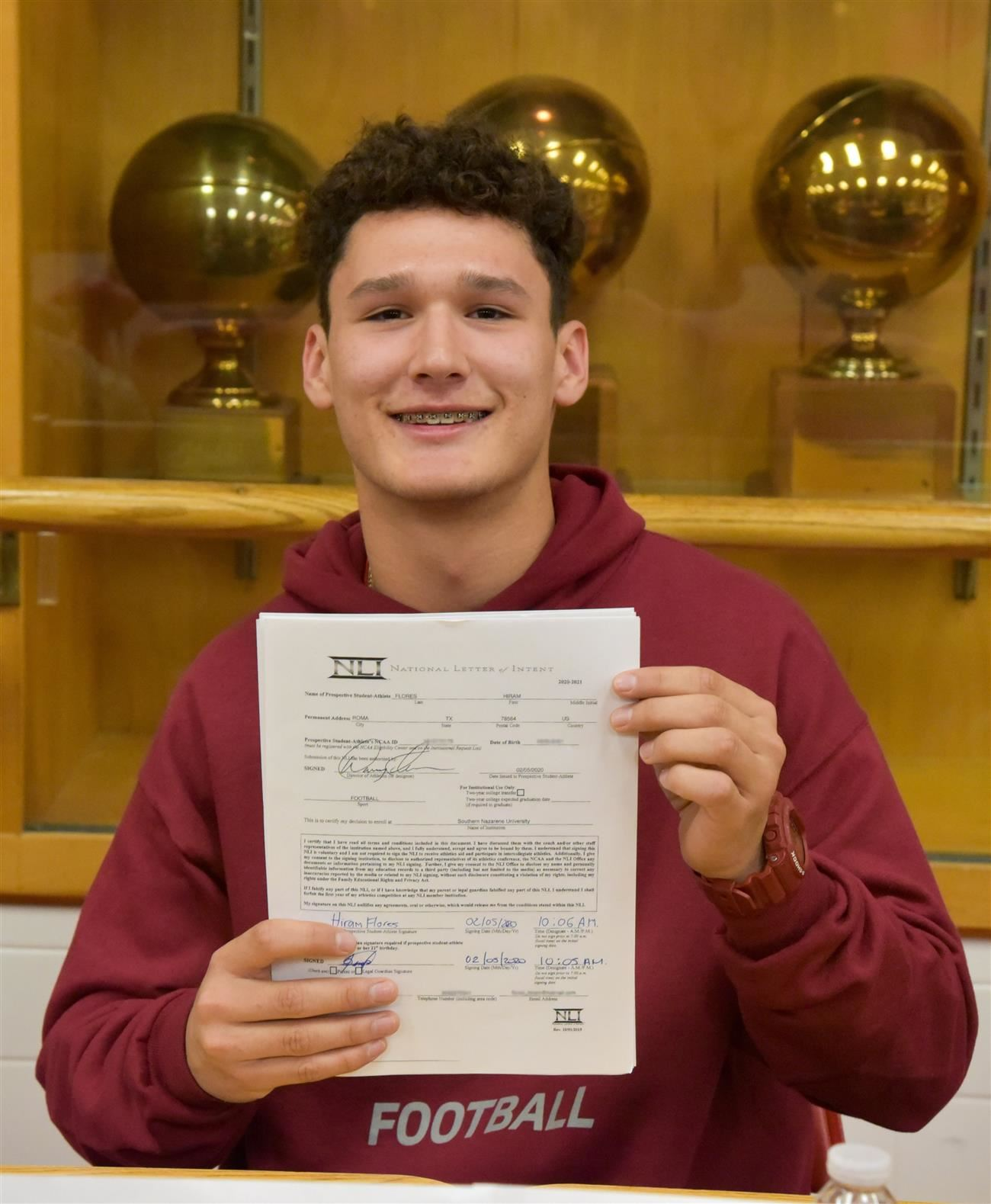Hiram Flores with his letter of intent.